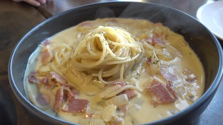 ソースパン : Carbonara Pasta with Bacon serve in hot pan 動画素材