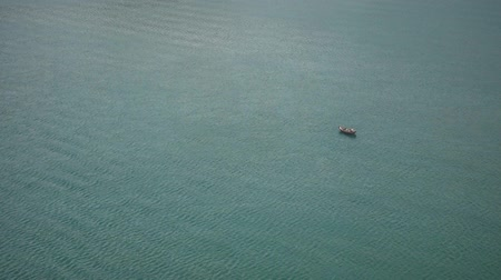 small vessels : Small Fishing boat floating on an open water top aerial view Stock Footage