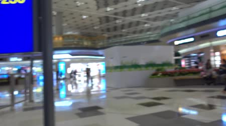 Two kids is running around in Hong Kong Airport 動画素材