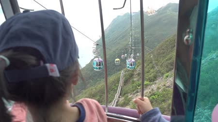 Children is riding on a Cable Car crossing mountain 動画素材