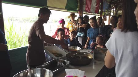Bangkok, Thailand - Dec 12, 2018: Family with small children are cooking in a Thai cooking class. 動画素材