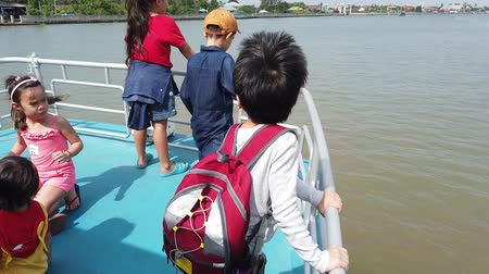 phraya : Bangkok, Thailand - December 16, 2018: Child are enjoying river boat ride in Bangkok river.
