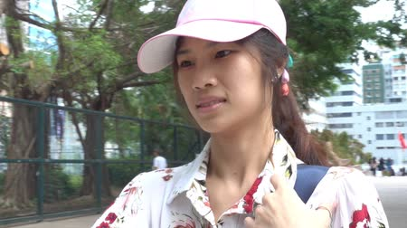 Woman is using Phone to guide direction in traveling in Hong Kong