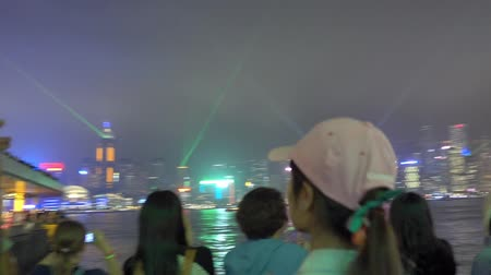 Hong Kong, Hong Kong - October 16, 2018: People are traveling in the Avenue of Stars to view the Symphony of lights show in Hong Kong. Stockvideo