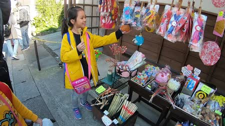 kanto : KAMAKURA, JAPAN - 2019 March 21: Children are shopping for Toy in Hase Dera Shopping Street.