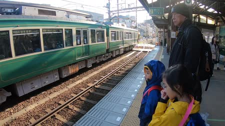 KAMAKURA, JAPAN - 2019 March 21: Family is waiting for the train at Hase Station.