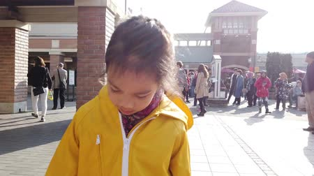 largest city : Tokyo, Japan - 23 March 2019 : Little girl is walking in Japanese Gotemba Premium Outlet. Stock Footage