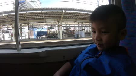 bala : Tourist boy is sitting on Japanese Bullet train in Tokyo Stock Footage