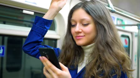 метро : Teen girl rides the subway and used smartphone
