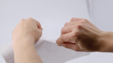 буклет : Slow motion of man hand tearing blank paper.