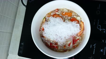 starch : put boiled bean vermicelli into white bowl and stir together with minced pork, chili, red onion, tomato garlic . Cooking for  Glass Noodle Pork Nut Spicy Salad (Yum Woon Sen)