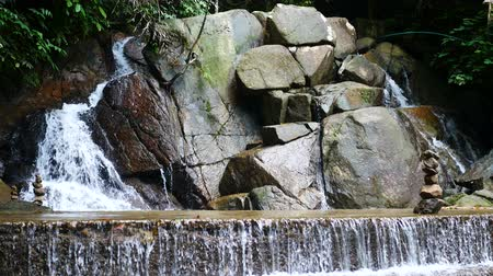 stacked rock : clear cold  waterfall flow into rock ,  stone sort successful concept Stock Footage