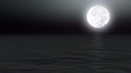 night scene : Full moon over calm sea at night  Stock Footage