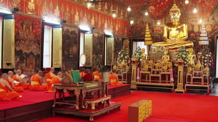budist : buddhist monks pray in temple