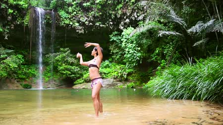 kalimantan : Sexy dancer on waterfall in borneo rainforest