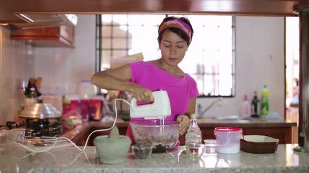 preparing : young mother preparing food at kitchen Stock Footage