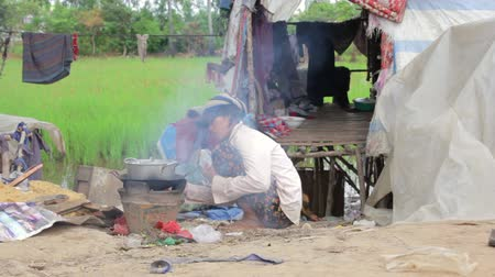 cooking pots : Mother preparing lunch in slums in stewpot