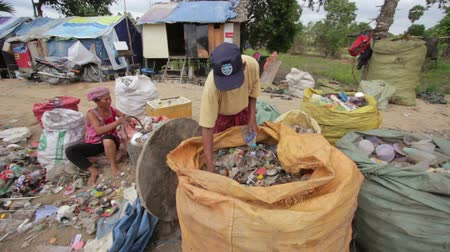 classify : Garbage gatherers assorting trashes in slums Stock Footage