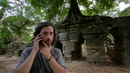 гнев : angry phone call, ruins in tropical jungle