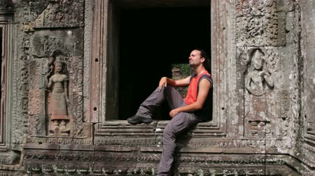 southeast : caucasian tourist travel in preah khan temple, angkor, cambodia