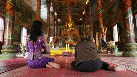 dua eden : Asian girl praying in temple, wat, pagoda, Phnom Penh, Cambodia