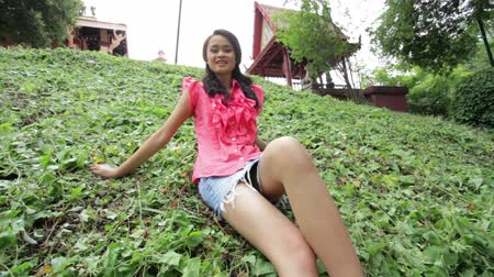 эротический : Sexy erotic asian girl with mini skirt on green grass