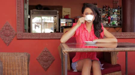 feketés csésze : gorgeous asian woman in cafe, drinking coffee, tea