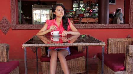 gorgeous : gorgeous asian woman in cafe, drinking coffee, tea