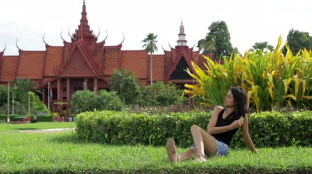 southeast : Asian attractive girl on grass, national museum, phnom penh, cambodia Stock Footage
