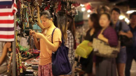 ıvır zıvır : Chinese Young Woman Shopping at asian night market Stok Video