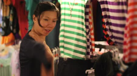 ruha : Chinese Young Woman Shopping at asian night market Stock mozgókép