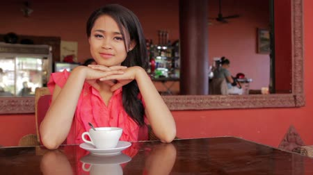 hot beverage : gorgeous asian woman in cafe, drinking coffee, tea