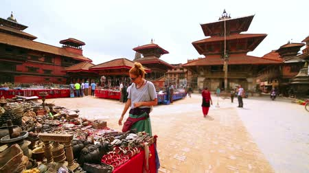 patan : Female tourist choosing souvenir at Patan Durbar Square, Kathmandu, Nepal
