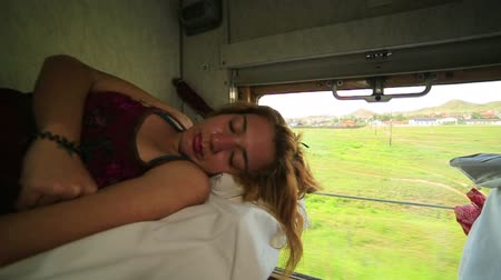 hátizsákkal : Woman sleeping during trans Siberian train journey, Russia Stock mozgókép