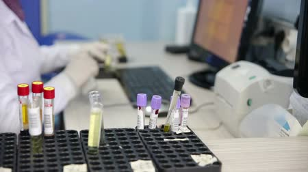 gen : Scientist testing blood samples in laboratory