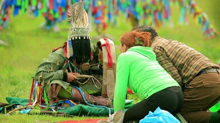 budist : Shaman ceremony, Ulaanbaatar, Mongolia. Their death fathers spirit enters to shamans body and he is talking through shamans body to his family members.