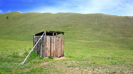 público : Mongolian wooden squat toilet outside home, grassland of mongolia