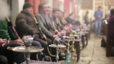 bazar : People smoking shisha at Nargile Cafe, Shisha place around Grand Bazaar, Istanbul