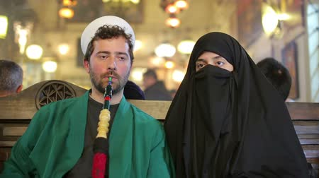 başörtüsü : Portrait of couple, smoking shisha
