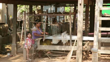 silkworm : SILK ISLAND, CAMBODIA - MARCH 2014: cambodian woman silk textile manufacturing at her house.