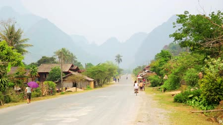 obec : Daily life of Vang Vieng village with limestone mountains, Laos