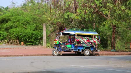 prabang : Single tuk tuk on road, Luang Prabang, Laos