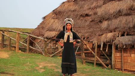 hill tribe : indigenous native tribal woman, Akha tribe village, Pongsali, Laos Stock Footage