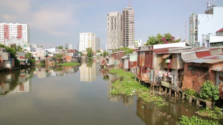chi : Ho Chi Minh City slums by river, Saigon, Vietnam