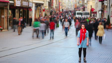 stojan : Young woman posing, busy street, people walking around, HD, wide angle view