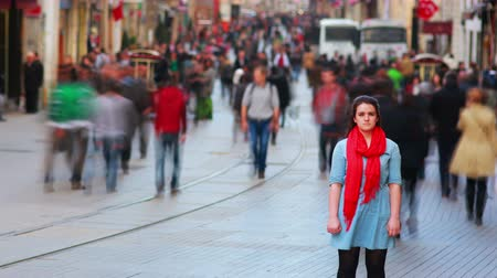 blur : Young woman posing, busy street, people walking around, 4K, close up Stock Footage