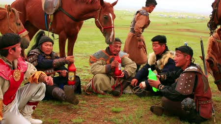 moğolistan : ULAANBAATAR, MONGOLIA - JULY 2013: Naadam Festival Horse Archery Crew with traditional medieval outfit before the show drinking kumis