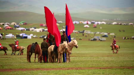 moğolistan : ULAANBAATAR, MONGOLIA - JULY 2013: Mongolian Cavalry at Naadam Festival . At background, polo games playing