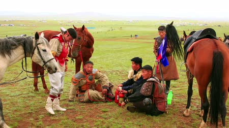 javelin : ULAANBAATAR, MONGOLIA - JULY 2013: Naadam Festival Horse Archery Crew with traditional medieval outfit before the show drinking kumis