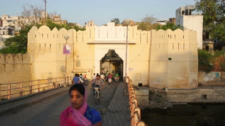 saray : UDAIPUR, RAJASTHAN, INDIA - APRIL, 2013: Everyday city life scene with traffic passing through bridge